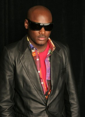 2face wearing a leather/pleather blazer in 102 degree weather. By the way the whole leather/pleather is so over unless  you're wearing tights or fairup (for ladies)
