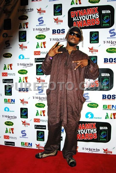 Some Naija Celebrity - I'm so sick and tired of Nigerian men thinking that Gucci goes with all outfits. This is an example. Because you're wearing a $500 shoe doesn't make the outfit hot. But I give you props for taking the fashion risk.