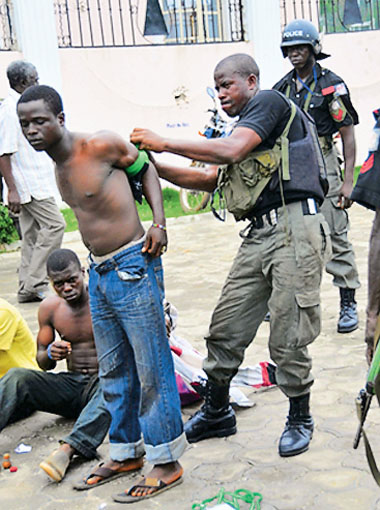 Suspected Political Thugs being bound by the Police Force