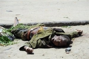 The body of an alleged self-styled Boko Haram member lies in a street in Maiduguri.