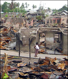 ODIOMA, NIGERIA: A villager walks through the ruins of the southern Nigerian community of Odioma, a fishing and trading centre, and a historic centre for the Ijaw people in the oil-rich Niger Delta. It was burned to the ground on 19 February 2005 by government troops hunting a local militia leader accused of ordering the murder of 12 people from a neighbouring village during a dispute over the ownership of the proposed site for a new oil well.