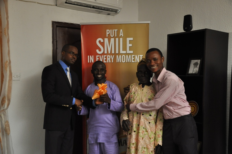 Oluwashola Akinsanya receiving the keys to his new home from Tokunbo Adodo Marketing Manager