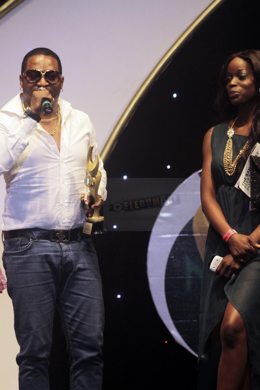 Olu Maintain with his NMVA plaque