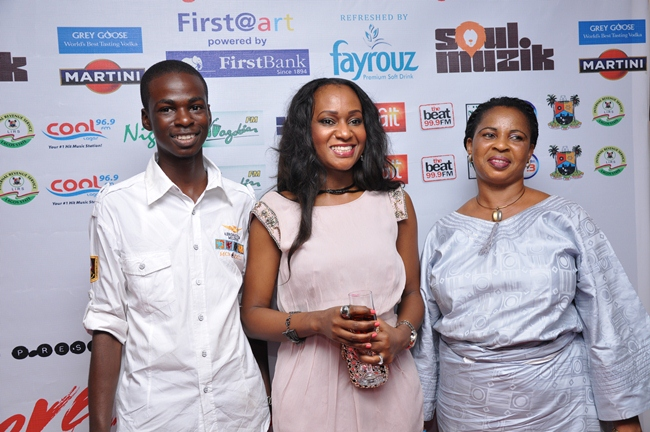 4 Daniel Ishola, ticket winner from Fayrouz_ Nnenna Hemeson Ifeibigh, Senior Brand Manager Fayrouz and Mrs Ishola