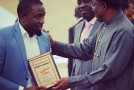 Chocolate City's Ice Prince & M.I As Rhythm & Play NASCOM Ambassadors. Receive Awards From President Goodluck Jonathan