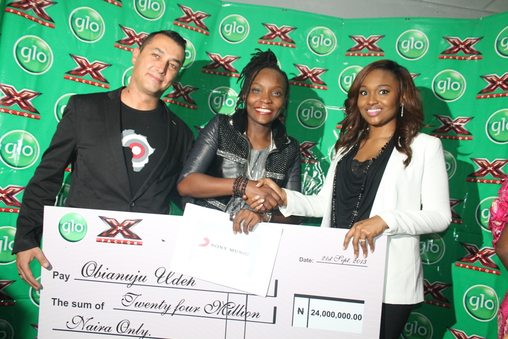 4. Globacom's Group Executive Director, Mrs Bella Disu (right) handing over a cheque for N24million to the winner of Glo X Factor singing reality show, DJ Switch. Left is Sony Music Marketing Director, Spiro Damaskinos.