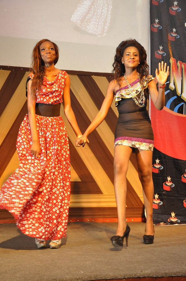 Kay Okonkwo of Ramore Couture taking a bow