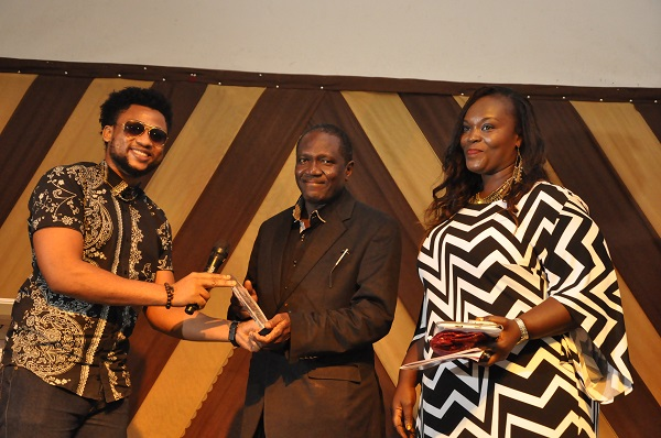 Larry Foreman presenting award to the marketing Manager Liberty FM Kaduna - Copy