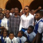 Flavour N'Abania Visits His Former Secondary School Wearing His School Uniform
