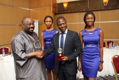 Dele Momodu Presenting Award to Tecno Mobile at Broad Awards ceremony