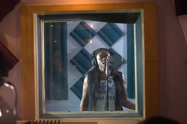 Waje in the recording booth (2)