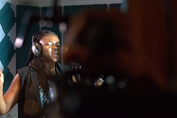 Waje in the recording booth